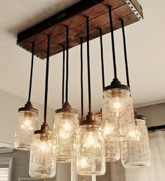 light fixture from mason jars. would be even better with those old timey bulbs where you can see the filament