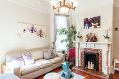 """""""I love that Apartment Therapy has the sources listed. It was so hard finding the pieces I like."""" High ceilings and windows give the apartment an airy vibe."""