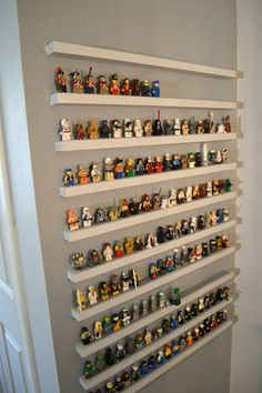 Jedi Craft Girl: DIY Lego Minifigure Storage Shelves Tutorial. I am DEFINITELY doing this when we buy our new house. Awesome.