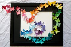 """How cool is this """"Butterflies in the Wind"""" art project!? I love how it looks like this rainbow of butterflies came to life and fluttered out of the picture frame! Follow the link to the DIY tutorial..."""