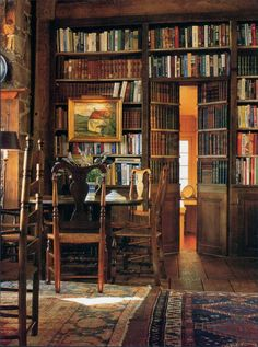 via This looks like a fabulous room and I think there's a fireplace to the left. Don't you love the secret book doors? I want to see more o...