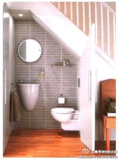 One way to use up extra space under the stairs... Could work, what does everyone else think?
