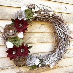 A snowy winter wreath to adorn your door well past the holidays.