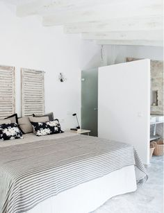 master bedroom spanish stone villa black white striped bedding floral pillows