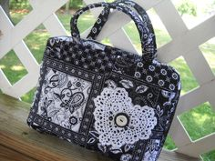 Black and White Quilted Zipper Bible Cover with White Doily, via Etsy.