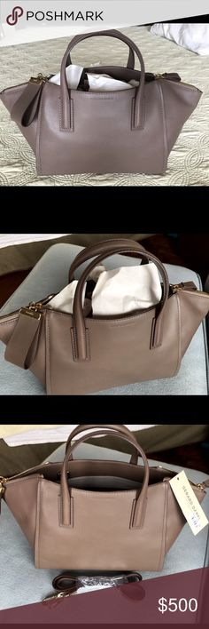 Beautiful NWT GERARD DAREL handbag This is one of my favorites however I have to let it go - This is brand new with tag still on and never used. It is a GERARD DAREL handbag in a luscious taupe color and has two zippers on side of bag. Handle bag with shoulder straps if wanted Gerard Darel Bags Shoulder Bags