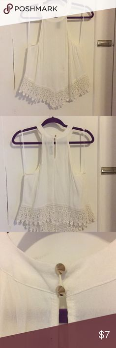 High neck tank with lace White high neck tank with lace bottom. Worn once ☝🏻 Tops Tank Tops