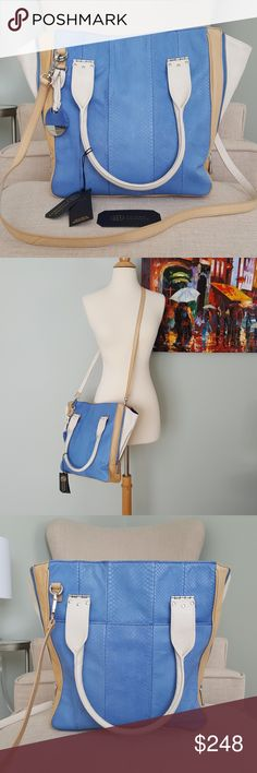 Hayden Harnett Margaux Blue Snakeskin Leather Tote This gorgeous bag is brand new with tags and comes with the authenticity card. It can be worn on the shoulder or across the body. It features genuine blue snakeskin and tan and white leather. Sides can zip up for a smaller size or be open as shown for more storage space. Has been stored on a shelf out of sunlight since purchased. Never carried, although there is a very small amount of minor shelf wear. Hayden Harnett Bags Totes