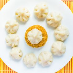 We all also know about Ganeshji's fondness for Modak.  Modak represents the reward in our life. It is in form of a triangle, with a small tip and large base. Modaks are a kind of dumplings in shape of triangle stuffed with a sweet filling.