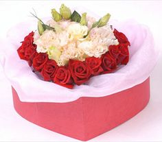 Love box  18 red roses, white balloon flowers in the middle, pink gauze put in the bottom of heart shape box.