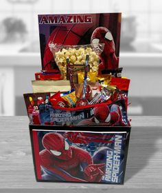 Any kid would be amazed with this fun filled box of Spider man toys & treats. Includes pencils, sharpener, zipper case, mini note pad, large notepad, folder, boxed candies, large candy bars & or m&ms, mini bars, pretzel sticks, pop corn, and cookies.  Substitutions of equal or greater value may be made depending on season and availability of product or container.      LOCAL AREA DELIVERY ONLY