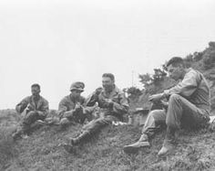 Break for C Rations, Korea. 1st Cav Div soldiers PFC Felix Gonzales of NY-13th Signal Corps; CPL Joseph P. Demt of Jacksonville, Fla., HQ Co; BRIG GEN Frank A. Allen of Cleveland, Ohio, Asst Com Gen; and 1st LT Alfred J. Millard of Wash DC