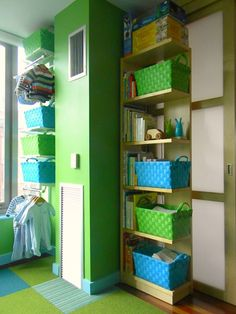 bright colors, lots of storage http://weedecor.com/2010/06/modern-owl-themed-nursery/