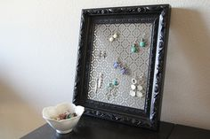 Cute decorative DIY earring holder made with sheet metal and a picture frame!