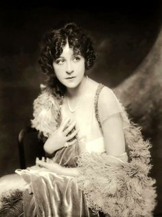 """This is Fanny Brice, whom Barbra Streisand depicted in Funny Girl and Funny Lady, both movies loosely based on her life. Fanny was a comedienne, singer, theater and film actress. She started in a burlesque revue. She moved up to be in The Ziegfeld Follies. The song most strongly associated with her is """"Second Hand Rose"""". On radio, she portrayed Baby Snooks-a bratty toddler always calling for """"daddy"""". It was very funny. She made only four films The Great Ziegfeld 1936 and The Ziegfeld Follies…"""