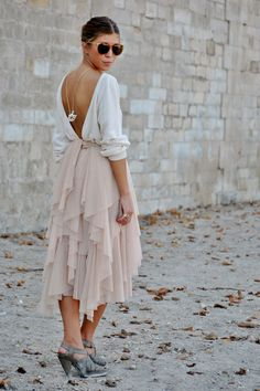 draped skirt, open back. so chic.