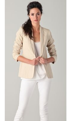 Tan sure adds warmth to an all white ensemble.
