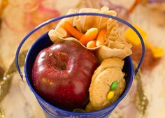 Pony party food. Apples, carrots, minature bales of hay (mini-wheats) and oatmeal cookies, served in a pail.