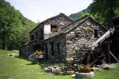 Stone cottage with a watermill  http://sphotos-f.ak.fbcdn.net/hphotos-ak-snc7/397676_482704415120123_2084010788_n.jpg