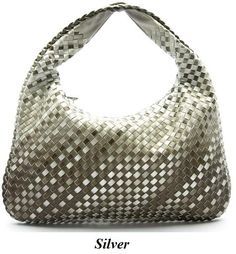 "This weaved textured faux leather hobo handbag with a 15 inch handle is stylish and on trend. Notice how the contrasting colors complement the design of this chic purse. It features a top zippered closure and inside lining with open/zip pockets. This bag is available in Bronze, Bug, Grey and Silver. H 10.5"" x W 17"". $29.99"
