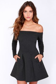 Even when it's cold outside, you can still unleash your inner vixen in the Cold Spells Charcoal Grey Off-the-Shoulder Dress! This enchanting long sleeve dress has a thick stretch knit to keep you warm, while showing off a little shoulder. Fitted bodice transitions into a full, box-pleated skirt with vertical front pockets. Hidden back zipper/hook clasp.Unlined. 60% Rayon, 35% Polyamide, 5% Spandex. Hand Wash Cold. Imported.