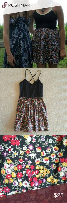 Victoria's Secret Dress This dress has a floral pattern on the skirt and a black stretchy material on the top. It is really comfy and great for summer! Victoria's Secret Dresses Mini