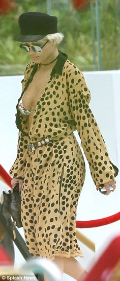 Polka dot princess:This time however Rita peeled her stunning wrap dress over the look which comprised of a camel base with large black polka dots emblazoned over the top