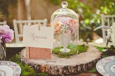 centerpieces in milk glass covered in apothecary jars // photo by nbarrettphotography.com