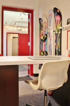 contemporary home office by Kimberley Bryan – nice idea: snowboards on the wall