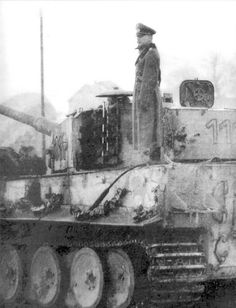A officer standing on the rear deck of Tiger 1 nr. 111