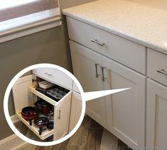 Slide out shelves in an East Moline kitchen remodel. | VillageHomeStores.com