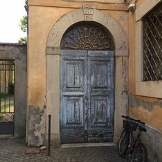Old double wooden door from Orvieto Italy, near to the Dome of Orvieto.