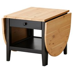 "ARKELSTORP Coffee table, black (IKEA) (""Solid wood is a durable natural material. A coffee table with drop leaves is easy to make larger or smaller according to your different needs."" 55 1/8"" L x 20 1/2"" H x 25 5/8"" W /// [Table top/ Rail/ Leg/ Drawer front: Solid pine, Stain, Clear acrylic lacquer; Drawer side/ Drawer back: Solid pine; Drawer bottom: Printed fiberboard; Drawer rail: Solid beech or birch)]"
