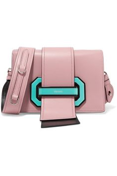 Prada's Spring '17 collection is filled with an array of new bags to covet, including this 'Ribbon' style seen in the hands of Leila Zandonai as she took to the runway. Masterfully made in Italy from smooth pink leather, its most distinguishable feature is the turquoise Plexiglas® clasp and oversized tabs. The compact interior has just enough room for the essentials – use the pockets to stow credit and business cards.