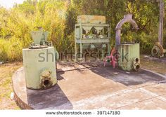 Phuket, Thailand - March 26, 2016: Old  Induced roll magnetic separator and other engines for tin mining works demonstrated at Phuket Mining Museum, Thailand - stock photo