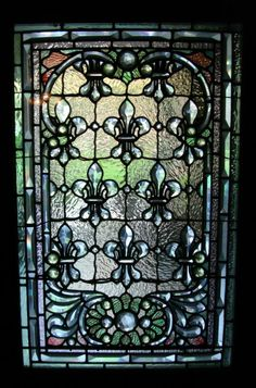 Beautiful stained glass Fleur De Lis Tiffany windows at the Winchester Mystery House in San Jose. Photo by Alexandra & Ben | More on the Winchester House at http://winchestermysteryhouse.com/index.cfm