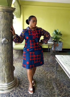 Call, SMS or WhatsApp if you want this style, needs a skilled tailor to hire or you want to expand more on your fashion business. African Dresses For Women, African Attire, African Wear, African Fashion Dresses, African Women, African Print Jumpsuit, African Blouses, Kente Styles, Short Gowns