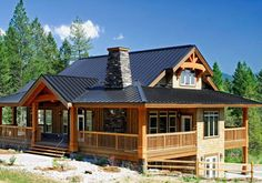 This wonderful post and beam cedar home design showcases timbercrafted elegance at its best!