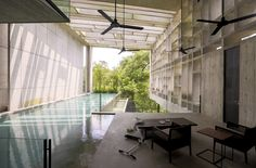 Ease of movement between areas and flown in dressing to indicate location for  scenes Tropical Box House / WHBC Architects