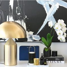 SPOTTED: the Atollo gold table lamp (used here in the office of @stevecordony Style Director at Large of @bellemagazineau) proves that brushed metal is the way to channel subtle luxury Click the link in our bio to shop the lamp. #luxdeco #interiorstyling #interiordesign #stevecordony #oluce #lighting #brushesmetal #ellemagazine