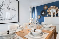 white dining room with pantone snorkel blue accent wall, dark blue, navy blue, indigo blue Blue Accent Walls, Blue Accents, Blue Walls, Indigo Walls, Snorkel Blue, Blue Rooms, Dining Table, Dining Rooms, Reading Nook