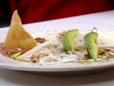 Chilaquiles in Green Sauce from FoodNetwork.com - My favorite food I had when we were in Mexico. I am going to make this.