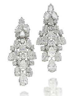 A PAIR OF DIAMOND 'CHANDELIER' EARRINGS, BY HARRY WINSTON  Each designed as a cascade of pear-shaped and brilliant-cut diamonds, mounted in platinum and gold, 5.5 cm Signed Winston and with maker's mark of Jacques Timey for Harry Winston