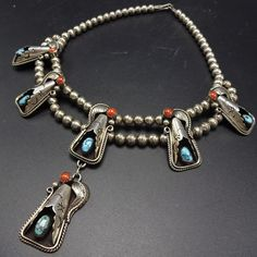 """Coral and turquoise grace the three-dimensional blossom, along a traditional double row of handmade sterling silver Navajo pearls. STERLING: unmarked, verified sterling silver. MEASUREMENTS: Necklace measures 17.5"""" end to end. 