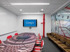 G Is For: Google's Eco-Friendly Chelsea Digs by HLW | A Queens subway map fronts a conference room furnished with a bench reclaimed from a station and a tabletop sporting a blown-up image of the metal token once used for a single fare.