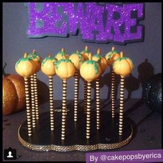 Love this display for a Halloween dessert table! Pumpkin Cake Pops in a Bling Pumpkin Cake Pop Stand #cakepops #cakepopstand