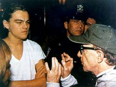 "Leonardo DiCaprio listens as writer/director Woody Allen gives him motivation on the set of ""Celebrity"", 1998."