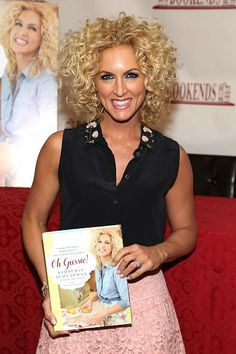 Little Big Town's Kimberly Schlapman shows off her new cookbook, Oh Gussie!, on April 15 in Ridgewood, N.J.