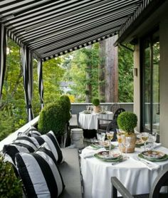 Luxury made simple. Nothing like white tablecloths to bring a 3 star up to a 5 star.  Plus a glamorous awning with matching big, bold black and white stripes.  Simple color looks smashing together.