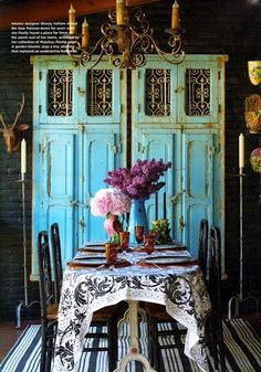 Vintage cabinet/wardrobe in turquoise paired with a chandelier amd a great table setting